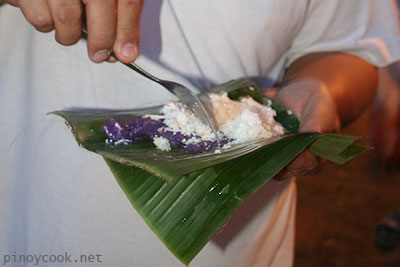 my husband enjoying his puto bumbong