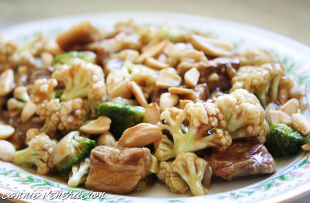 Pork and vegetables stir fry with pili nuts