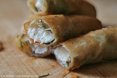 spring rolls with fish fillets and fresh dill