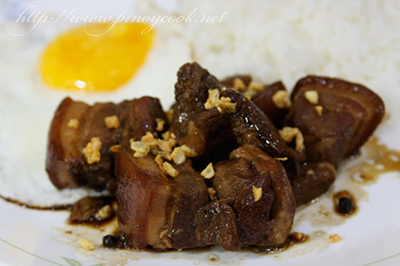 pork adobo sprinkled with toasted garlic bits, fried egg and rice