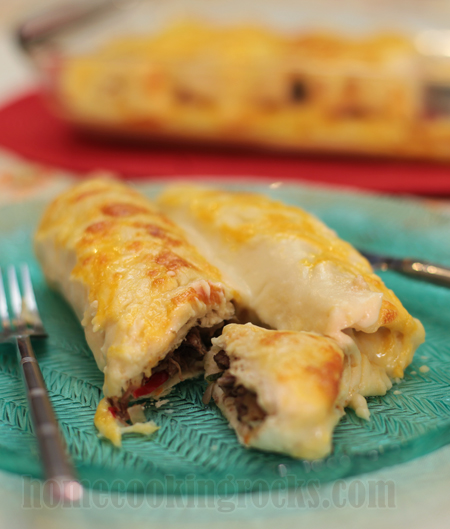Beef and mushroom enchiladas with white sauce
