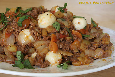 casaveneracion.com ground beef, potatoes, onions, garlic and tomatoes cooked a la menudo and garnished with hard-boiled quail eggs