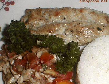 Grilled bangus (milkfish) with tomato and itlog na maalat (salted egg) salad