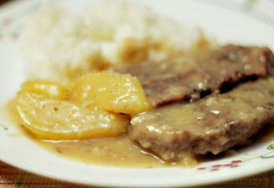 Boiled beef with gravy and potatoes