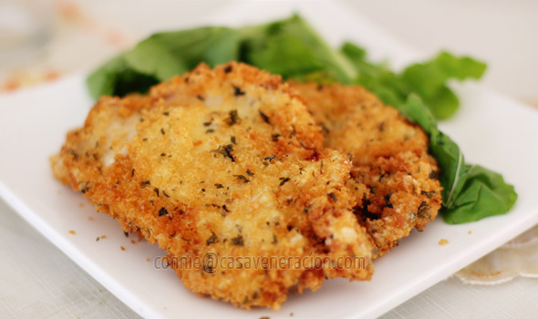 A la chicken schnitzel or milanesa (fried breaded escalopes)