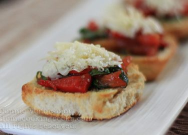 Bruschetta with tomatoes, basil, pimiento and cheese