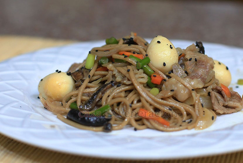 Stir fried noodles with garlic stalks, mushrooms and quail eggs