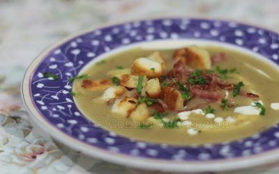 Potato and bacon soup with croutons and cream
