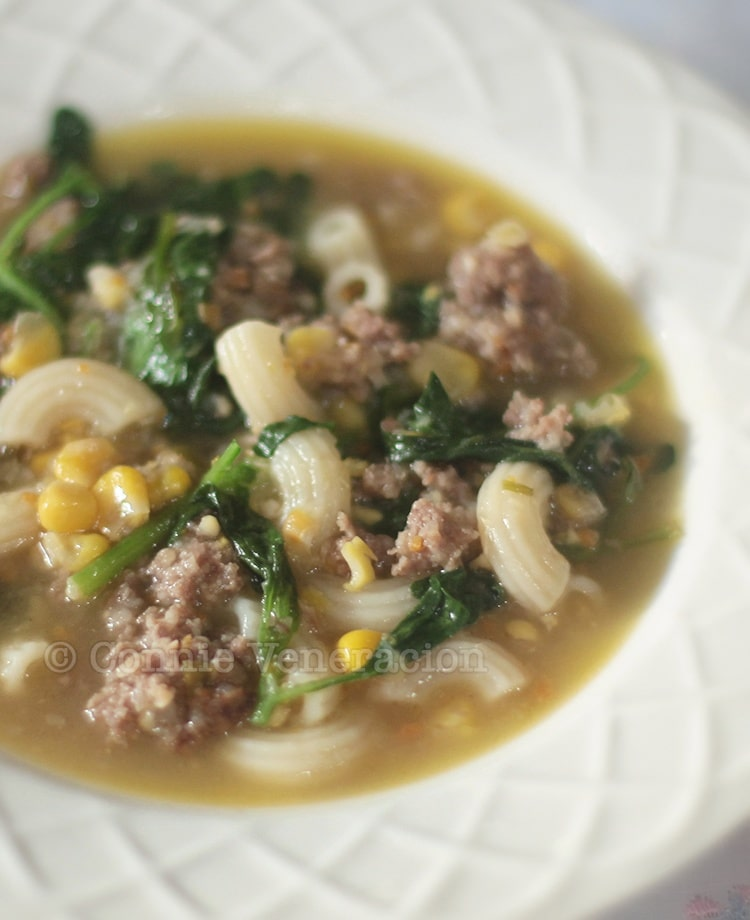 Macaroni soup with meatballs corn and spinach
