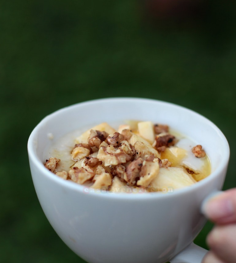 Oatmeal porridge with fresh apples, toasted walnuts and honey
