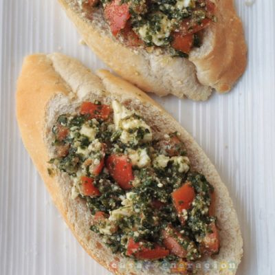 Bruschetta with pesto, tomatoes and feta cheese