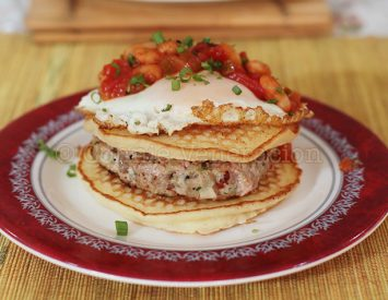 Pancakes, burger, egg and chili breakfast