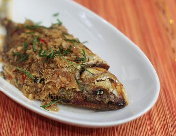 Whole fish braised in lemongrass and ginger sauce