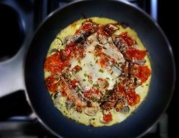 Pizza-style open-faced sardine omelet