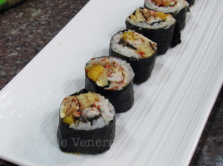Japanese rice rolls with milkfish fillet, scrambled egg and mango
