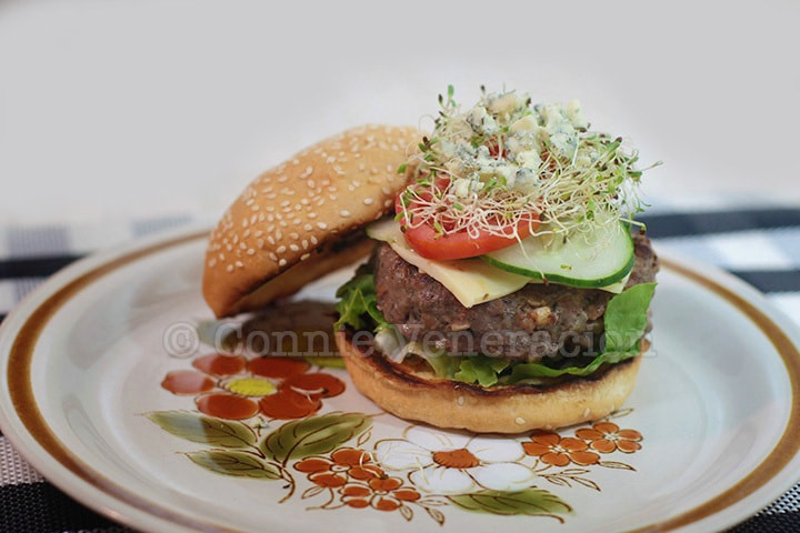 Burger with alfalfa sprouts and blue cheese