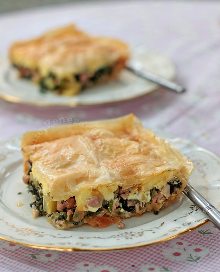 Serve the phyllo chicken mushroom spinach pie while hot.