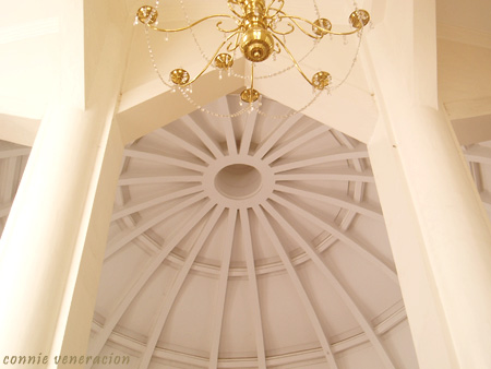 a chandelier and the domed ceiling of the Antipolo Cathedral