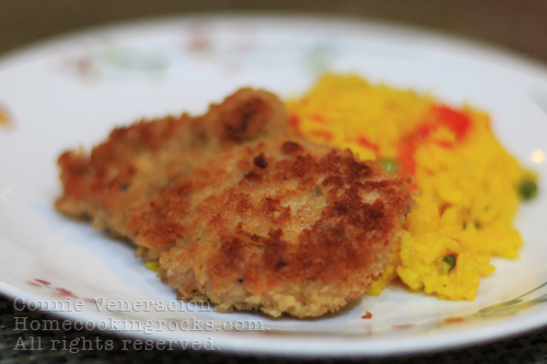 casaveneracion.com Herbed and breaded chicken with paella-style rice