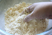 baking potato and raisin scones: cutting the butter into the flour mixture