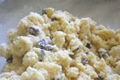 baking potato and raisin scones: mixing the mashed potatoes and raisins into the butter-flour mixture