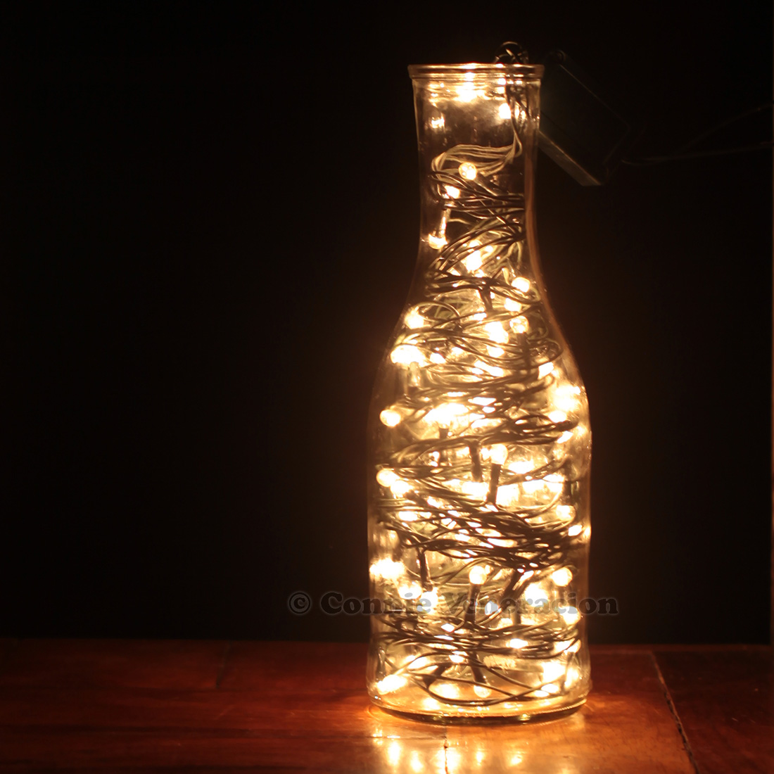 Blinking Christmas lights inside a bottle