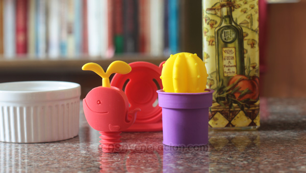 casaveneracion.com colorful silicone salt shaker, egg separator and bottle stopper in fancy shapes and colors