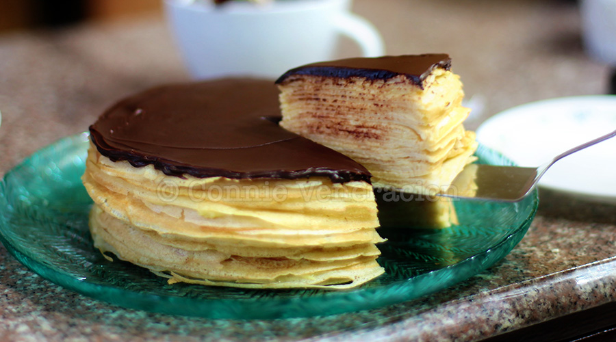 Custard-filled crepes cake with dark chocolate ganache topping | casaveneracion.com