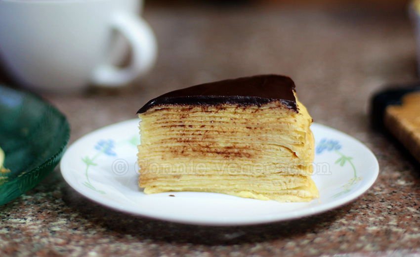 casaveneracion.com Custard-filled crepes cake with dark chocolate ganache topping