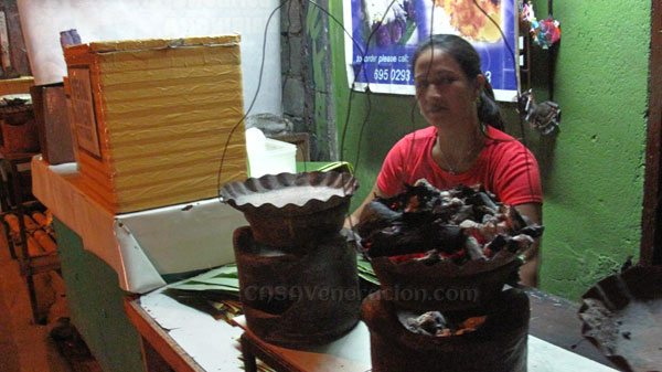 casaveneracion.com Bibingka, Filipino rice cakes baked in a special clay pot, lined with a piece of banana leaf, with live coals on top and underneath.