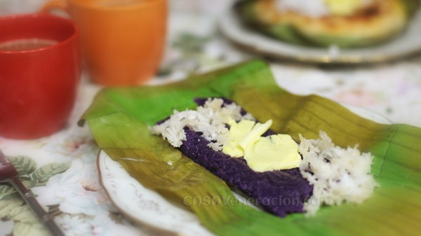 casaveneracion.com Puto-bumbong is a rice cake in tube form made from purpled-colored ground rice cooked in bamboo tubes that are placed on a special steamer-cooker. Then, they are removed from the bamboo tubes, spread with butter and sprinkled with sugar and grated coconut