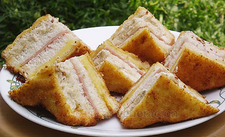 Dipped in beaten eggs, covered with bread cumbs and fried, these cliff sandwiches have chicken salad, ham and cheese. Delicious and filling!