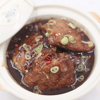 Grilled chicken stewed in vinegar, soy sauce, sugar, garlic, shallots and chili. It's a Filipino sweet sour chicken stew a.k.a. paksiw na lechon manok.
