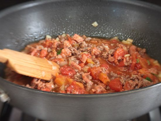 A good pasta sauce has different meats and plenty of vegetables -- onions, tomatoes, carrots, bell peppers -- and fresh herbs (basil is a favorite) for flavor.