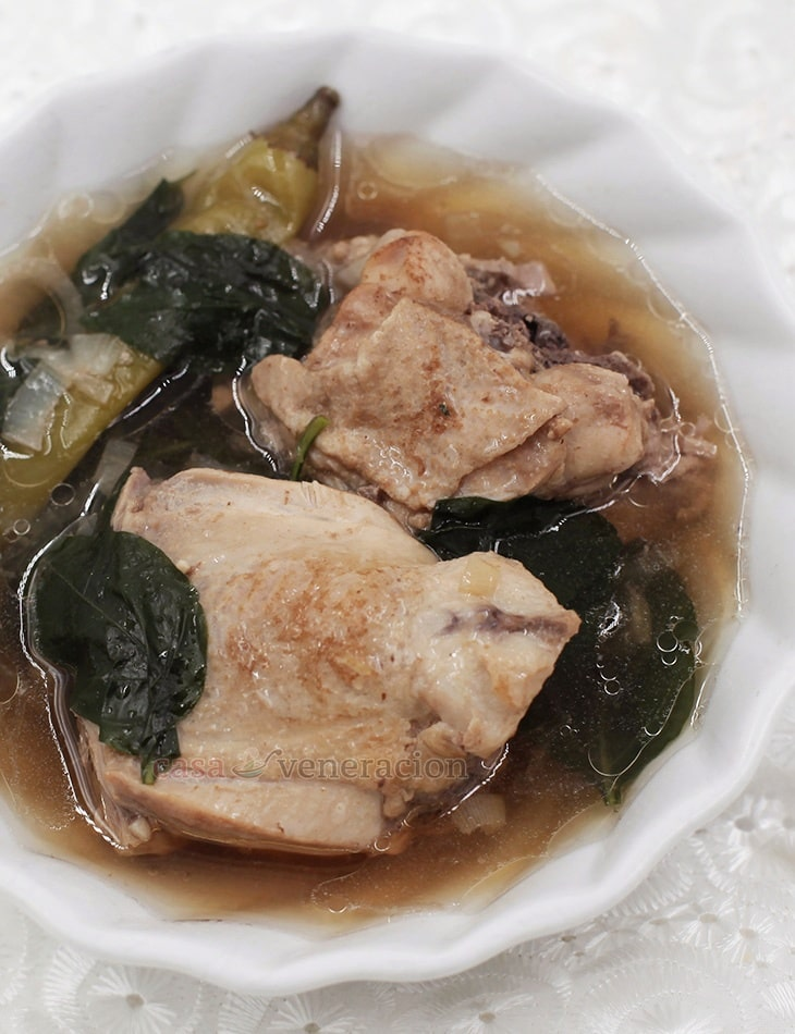Pinatisang manok is a Filipino soup with bone-in chicken cooked in broth seasoned with fish sauce and garnished with chili leaves.