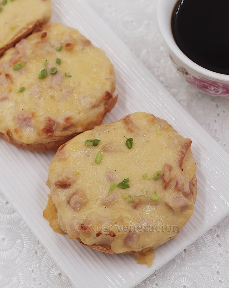 Make bechamel sauce, stir in a little mustard, plenty of chopped ham, mozzarella and cheddar. Spread on toasted split buns and broil until the cheesy topping is melted and lightly browned. These ham and cheese toasties make a delicious and filling breakfast.