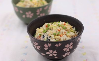 Flaked tinapang bangus (smoked milkfish) is stir fried with rice, chopped carrot, shredded cabbage, cauliflower florets, scallions and eggs