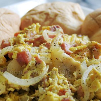 Scrambled eggs with ham and onions