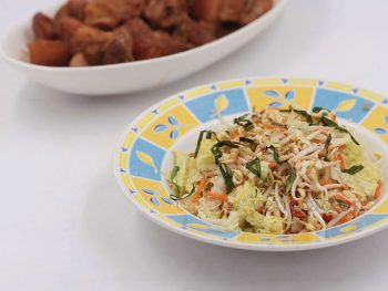Light, bright and citrusy, this Asian coleslaw is garnished with toasted cashew nuts and sesame seeds.