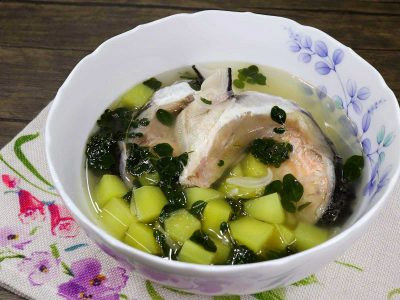 Fish and malunggay soup in white bowl