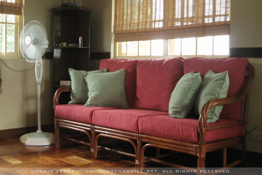 casaveneracion.com Couch with a rattan frame and red upholstery