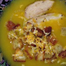 Squash, potato and chicken soup with croutons and cheese