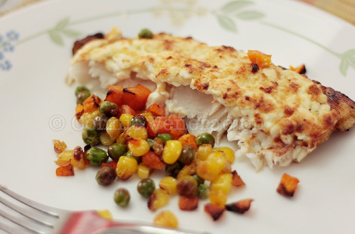 Baked fish fillet with cream cheese and mayo topping