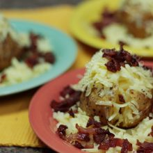 Cheesy baked potatoes with crispy bacon