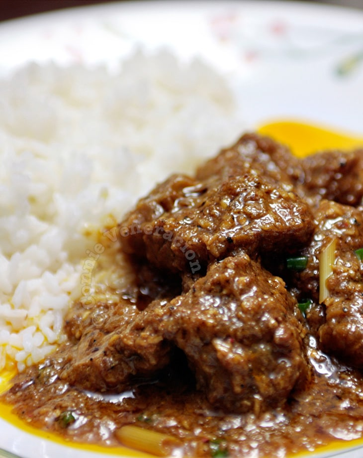 Beef rendang with spice paste ground using a mortar and pestle