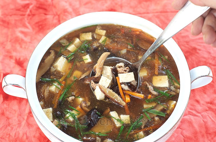 The Chinese hot and sour soup is a thick soup with robust flavors that come from chili, soy sauce, ginger and black vinegar. It includes mushrooms, meat, vegetables and tofu.