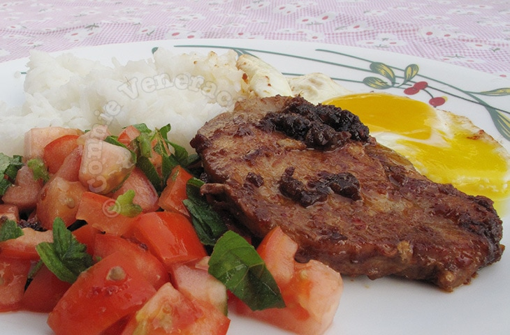 Spicy pork steaks with tomato and mint salad