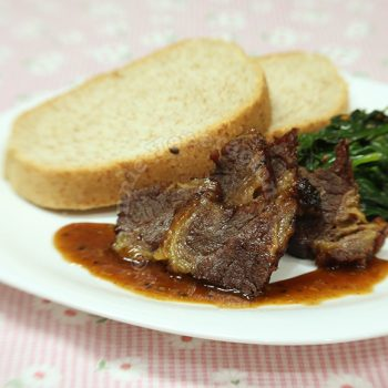 Barbecued beef brisket and garlicky spinach