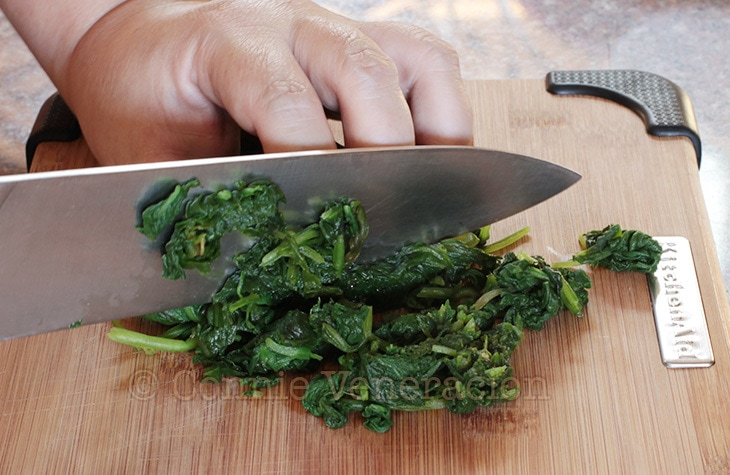 Squeezing excess water from spinach