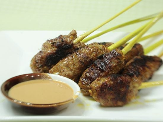 Grilled pork in lemongrass stalks